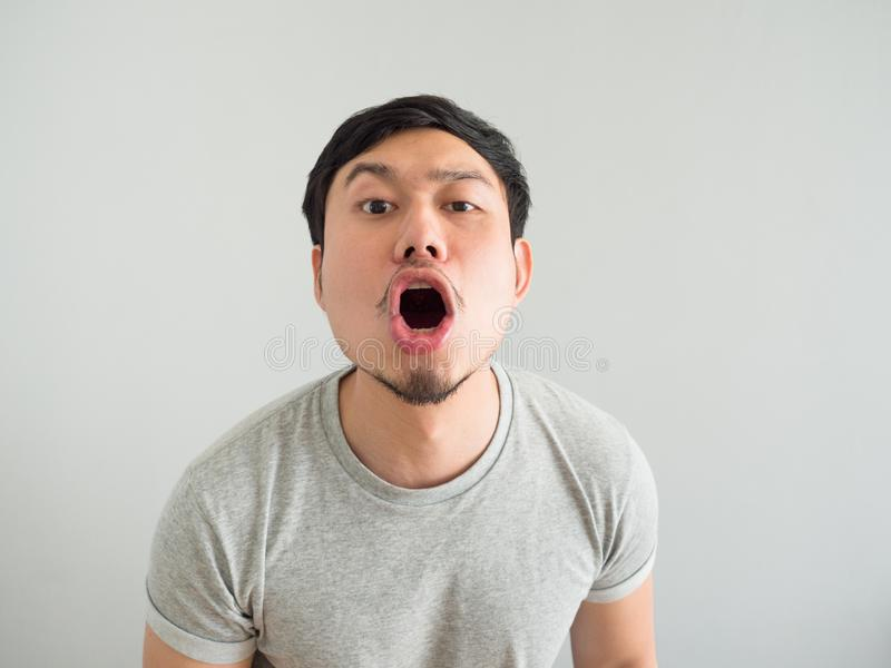 Funny face of bad breath man. Funny face of bad breath Asian man royalty free stock image