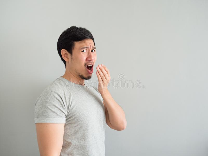 Funny face of bad breath man. Funny face of bad breath Asian man stock photography