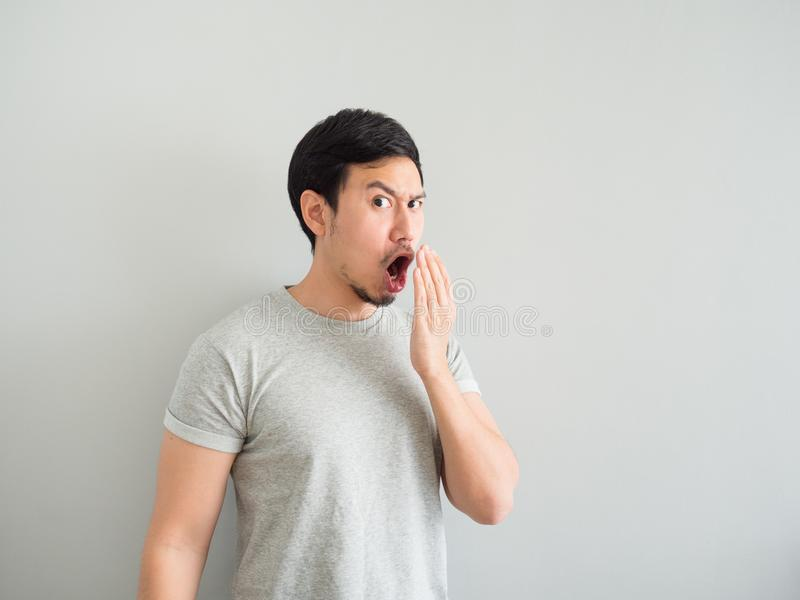 Funny face of bad breath man. Funny face of bad breath Asian man royalty free stock photos