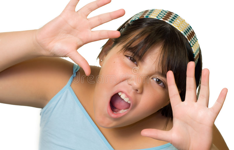 Funny Face Child. A young girl making a funny face, isolated on a white background royalty free stock photo