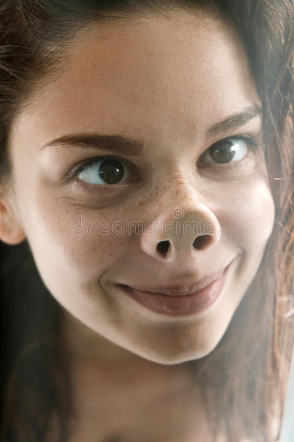 Funny face of cute silly female teenager stock photos
