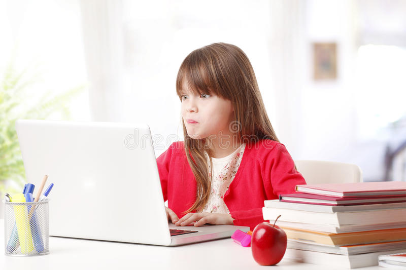 Funny face little girl royalty free stock photography