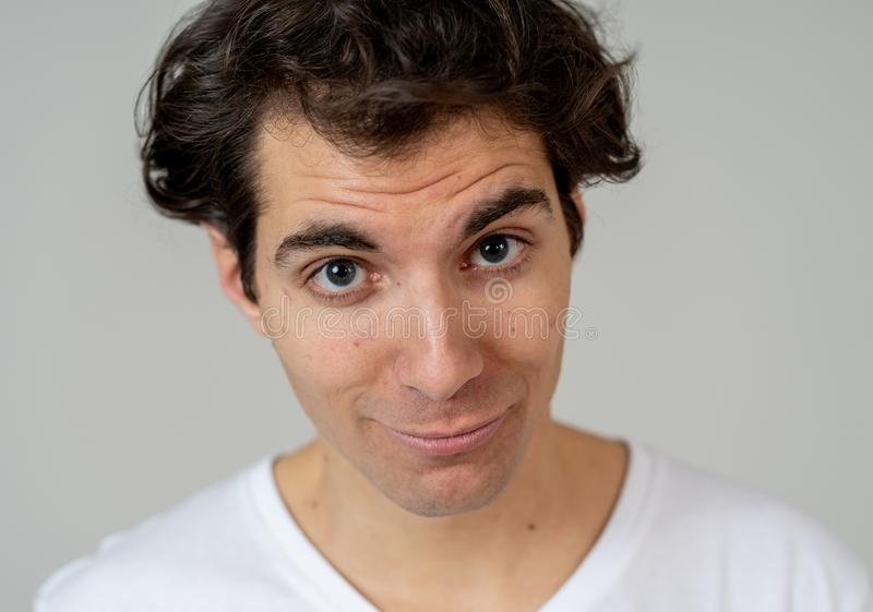 Funny face. Portrait of young man making amusing gestures royalty free stock photo