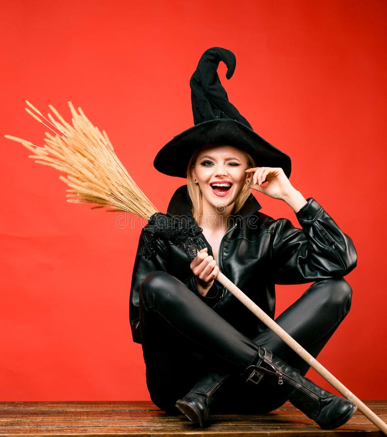 Funny face and Surprised woman. appy gothic young woman in witch halloween costume. Heppy Halloween. Witch broom or. Broomstick royalty free stock photos