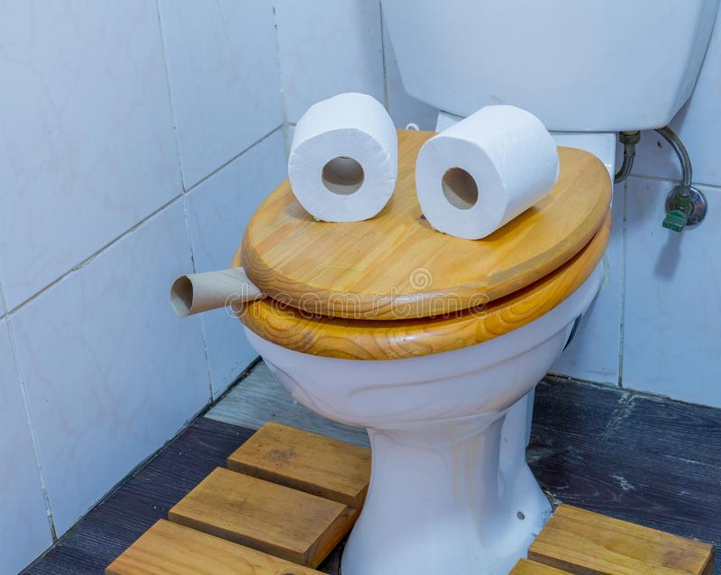 Funny face on a toilet seat humor concept royalty free stock image