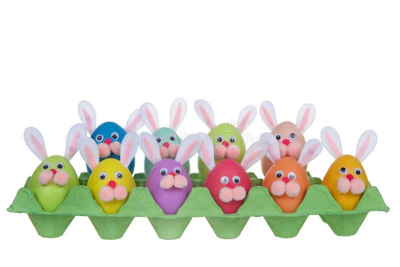 Funny faces bunny easter eggs in an egg carton stock photos