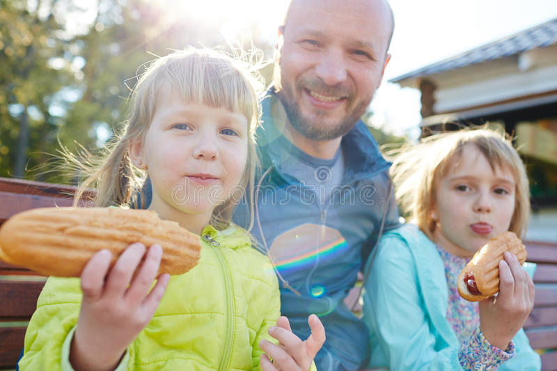 Funny Family with Hot Dogs stock image