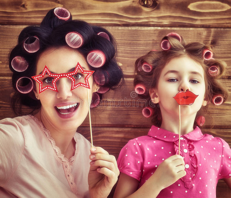 Funny family with a paper accessories royalty free stock photo