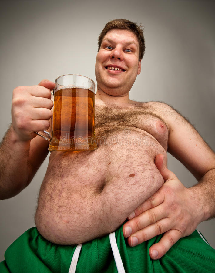 Funny fat man with glass of beer. Portrait of funny fat man with glass of beer royalty free stock photography