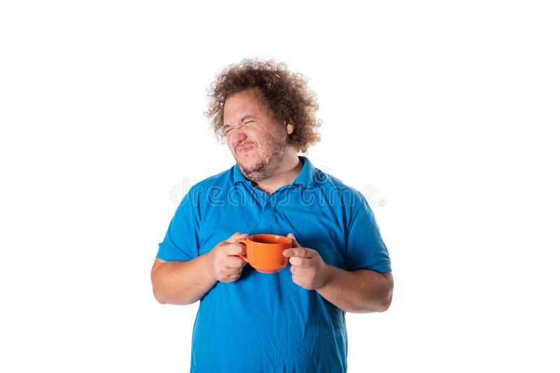 Funny fat man with mug. Good morning. And hot drink stock images