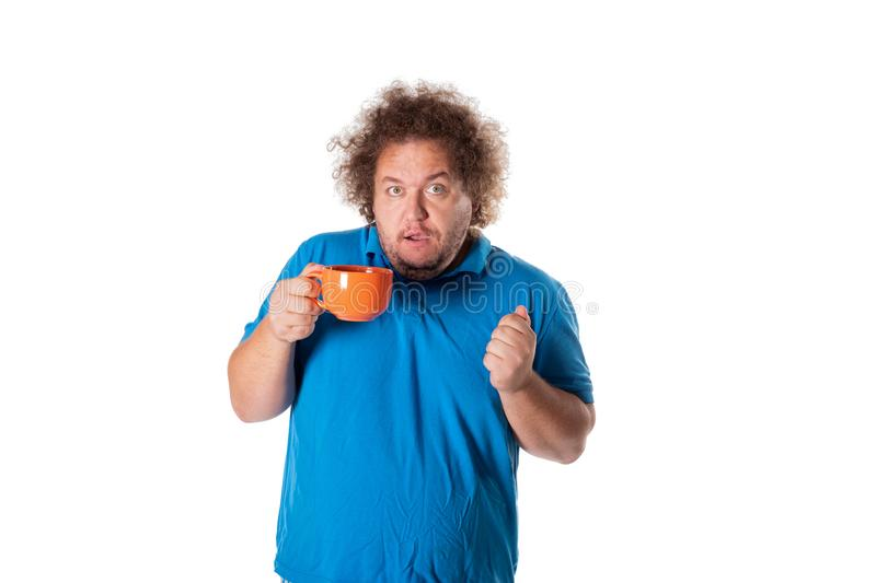 Funny fat man with mug. Good morning. And hot drink stock image
