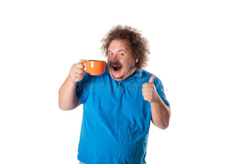 Funny fat man with mug. Good morning. And hot drink royalty free stock images