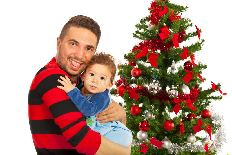 Funny father and his son near Xmas tree royalty free stock photo