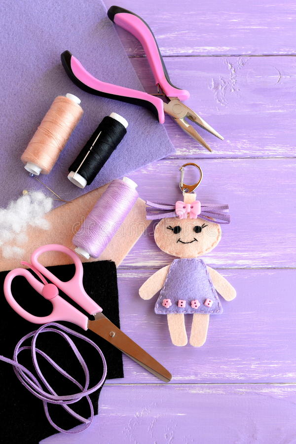 Funny felt doll keychain. Sewing supplies for toys. DIY kids embroidery inspiration. Top view. The art crafts. Art craft supplies royalty free stock photos