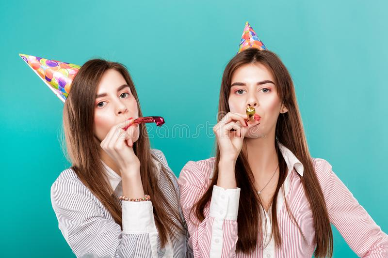 Women in birthday hat on blue background. stock photography