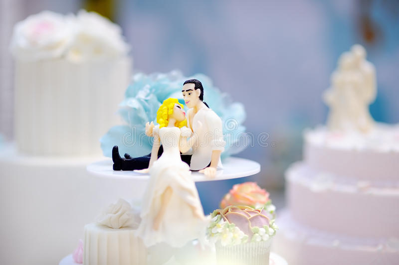 Funny figurines bride and groom stock photos