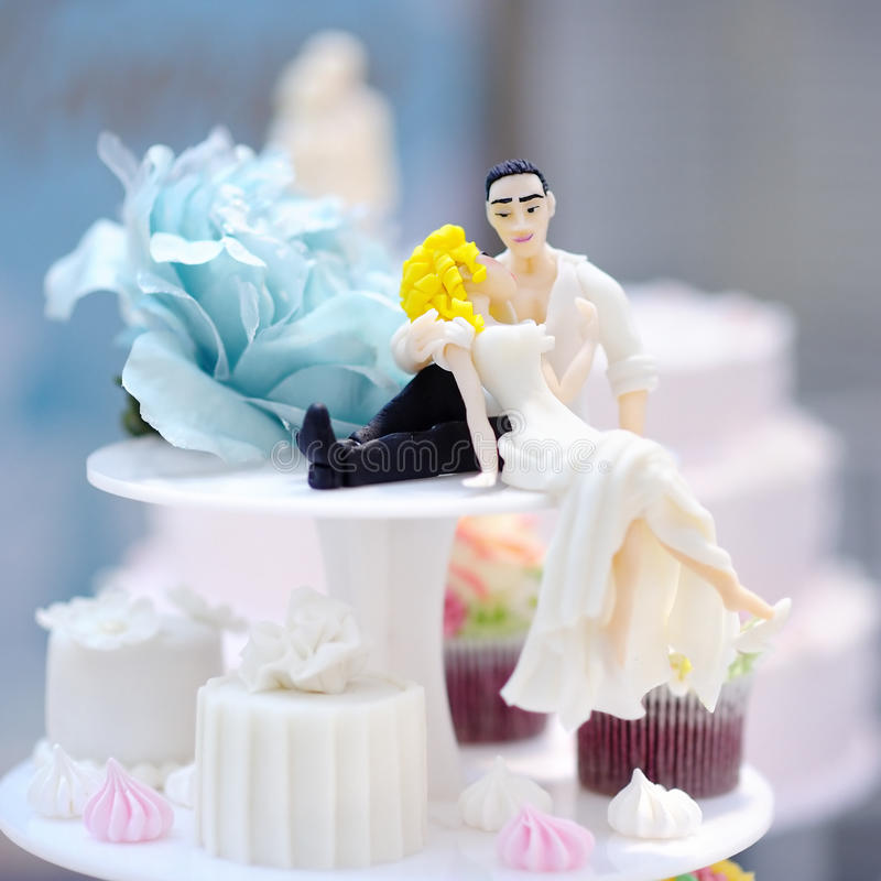Funny figurines bride and groom stock photography