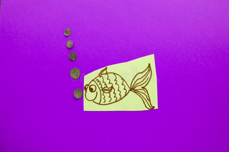 Funny fish with bubbles on purple background, fool`s Day.  royalty free stock photo