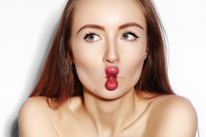 Funny Fish Lips Face with Exprissive Emotions. Beautiful Model Girl with Makeup, Red Lip, Perfect Skin. Fishlips royalty free stock photography