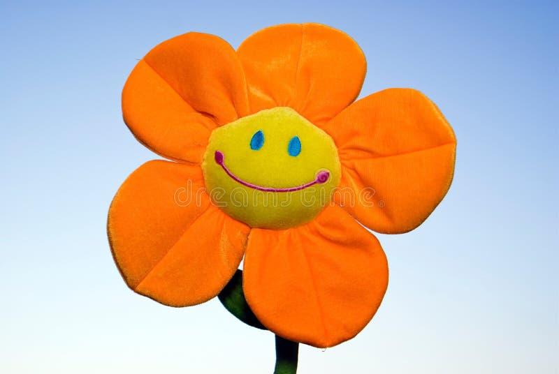 Funny flower. On blue sky stock photo