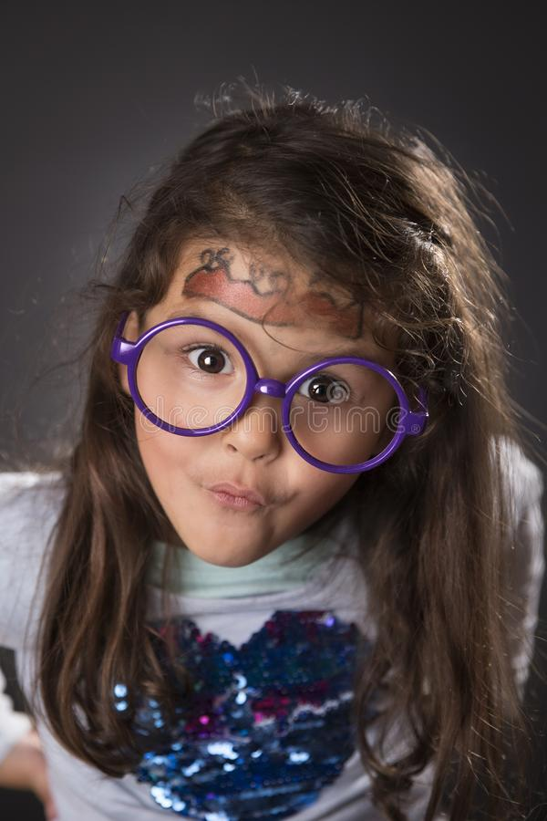 Funny four years girl making faces stock images