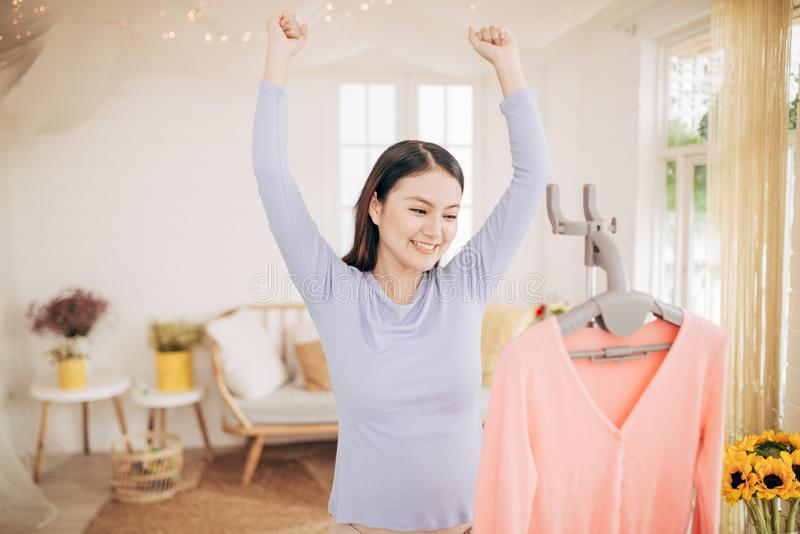 Funny foxy woman dancing with steamer iron. Housewife having fun while ironing clothes.  royalty free stock images