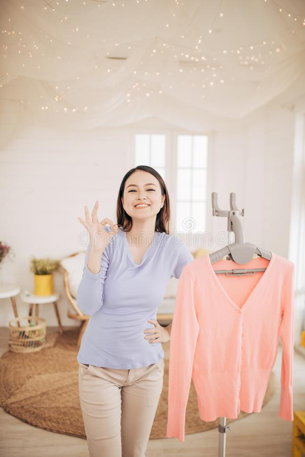 Funny foxy woman dancing with steamer iron. Housewife having fun while ironing clothes.  stock photos
