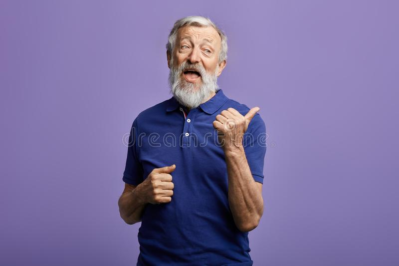 Funny friendly kind man thumbing to the side stock photos