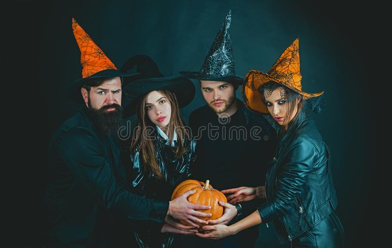 Funny friends at a Halloween party. Happy Halloween. Halloween group. Enjoying nice Halloween together. stock photography