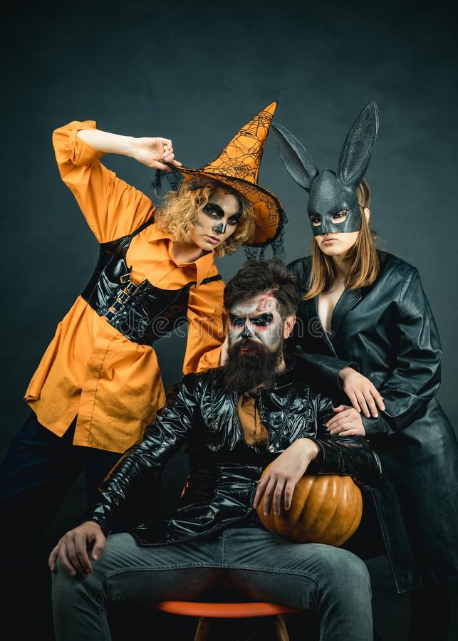 Funny friends at a Halloween party. Happy Halloween group. Enjoying nice Halloween together. Best friends celebrated royalty free stock photo