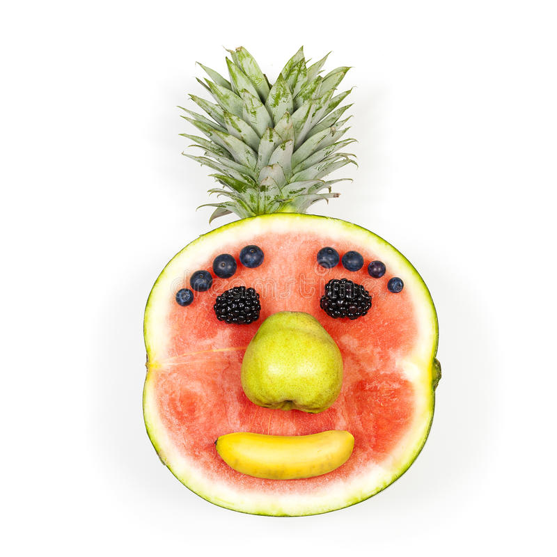Funny fruit face. Isolated over white background royalty free stock image