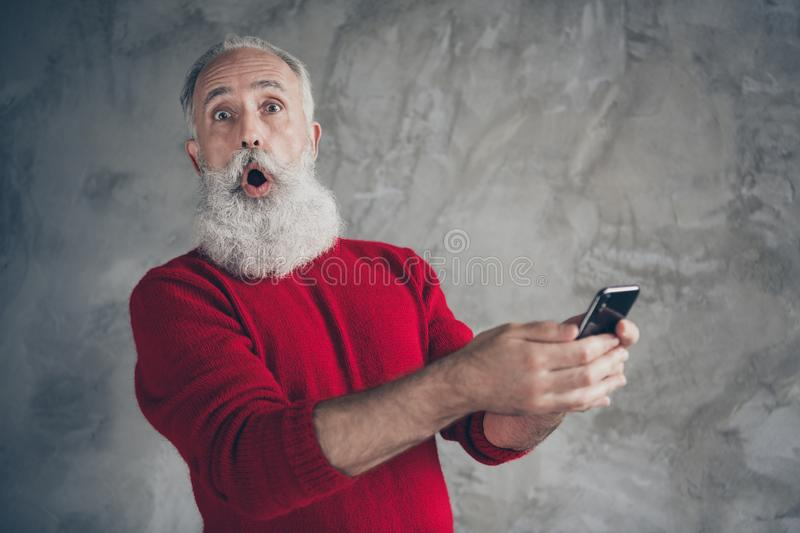 Funny funky crazy white hair beard old man use his smartphone blogging get x-mas newyear season tradition discounts. Funny funky crazy white hair beard old man royalty free stock image