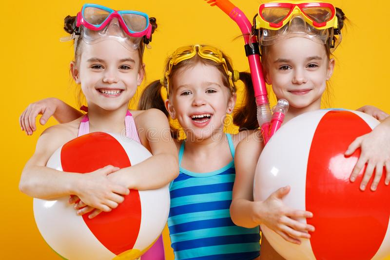 Funny funny happy children in bathing suits and swimming glasses stock images