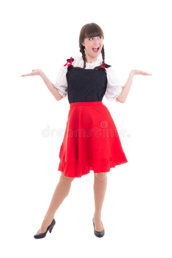 Funny german woman in typical bavarian dress dirndl. On white stock image