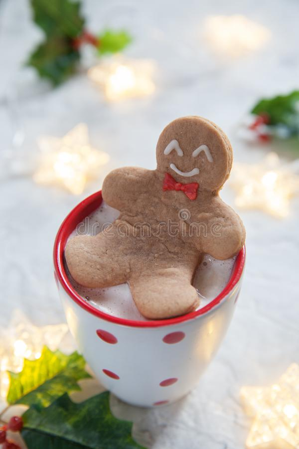 Gingerbread cookie man in a hot cup of chocolate. Funny gingerbread cookie man in a hot cup of chocolate royalty free stock photography