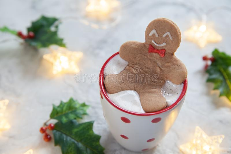 Gingerbread cookie man in a hot cup of chocolate. Funny gingerbread cookie man in a hot cup of chocolate stock photo