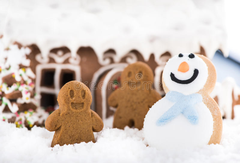 Funny gingerbread kids play on snow. Happy winter time stock images