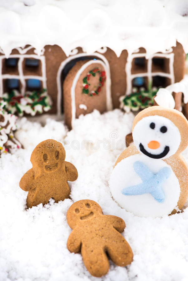 Funny gingerbread kids play on snow. Happy winter time royalty free stock photo
