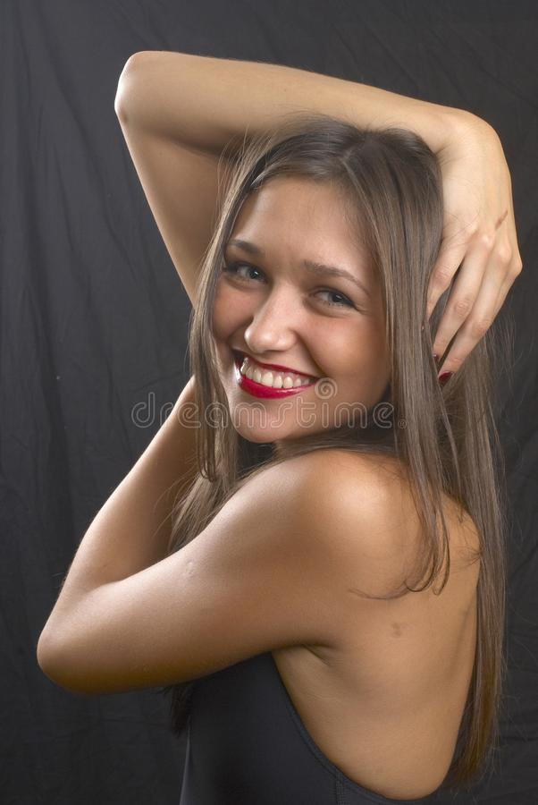 Funny girl. Young funny smiling woman in studio stock images
