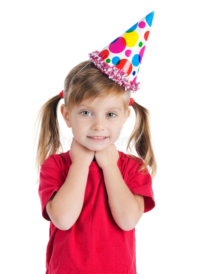 Funny girl in birthday cap. Isolated on white royalty free stock images