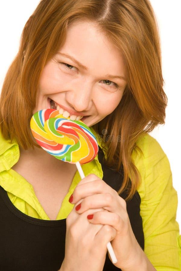 Funny girl bites Lollipop royalty free stock images