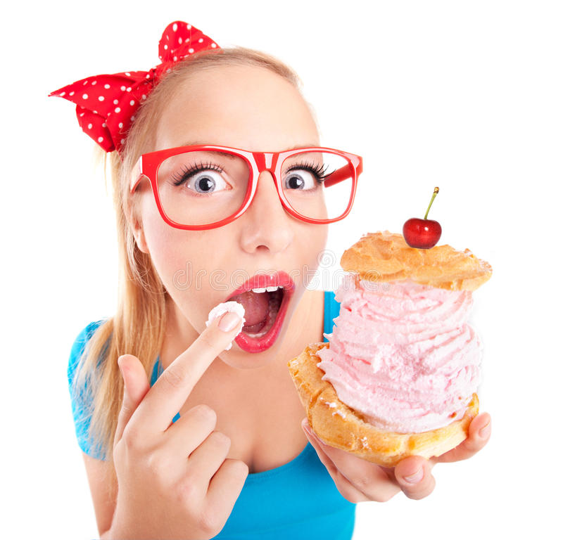Funny girl eating a cream puff royalty free stock images