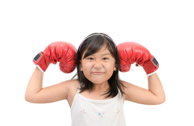 Funny girl fighting with red boxing gloves isolated. On white background, exercise and healthy concept stock image