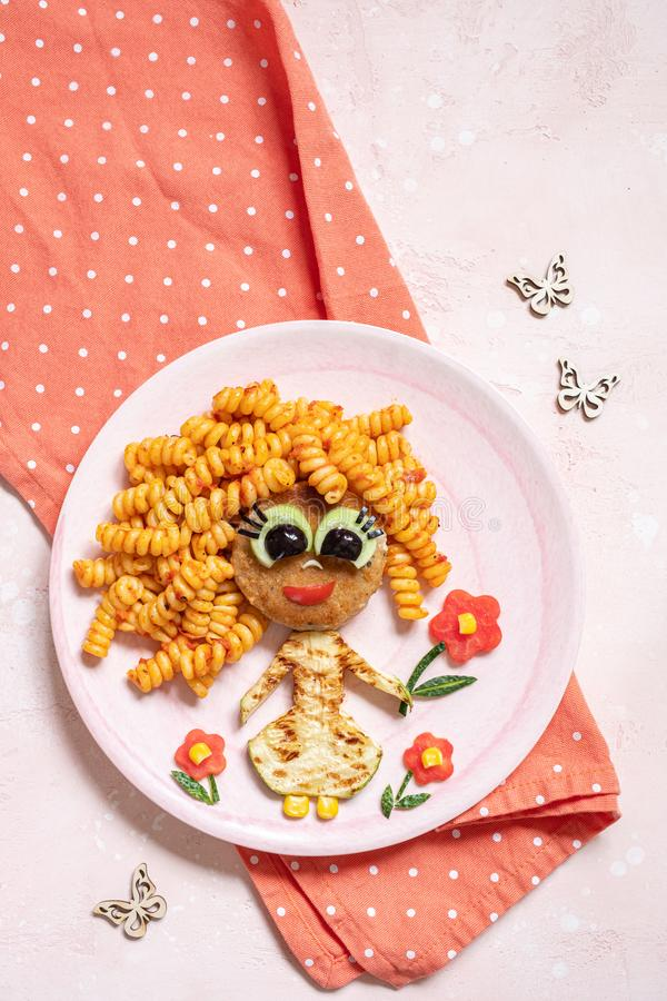 Funny Girl Food Face. With Cutlet, Pasta and Vegetables royalty free stock images