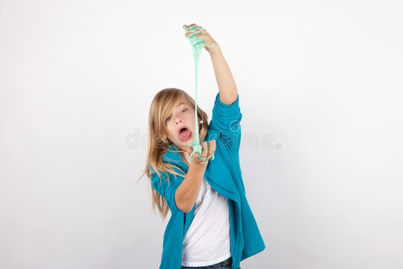 Funny girl fooling around with slime royalty free stock photo