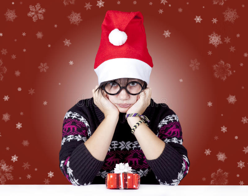Funny girl in glasses with christmas gifts. stock images