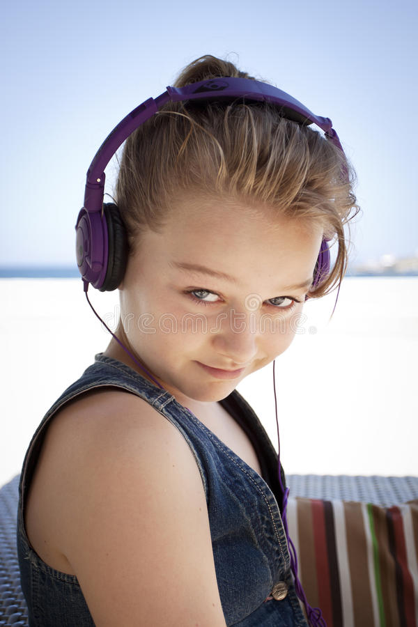 Funny girl with headphones stock image