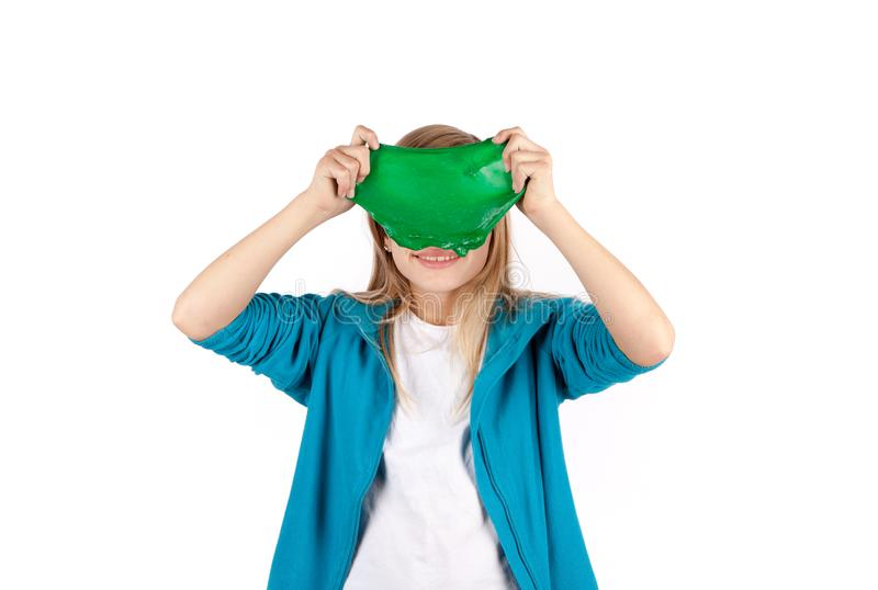 Funny girl holding a green slime stock images