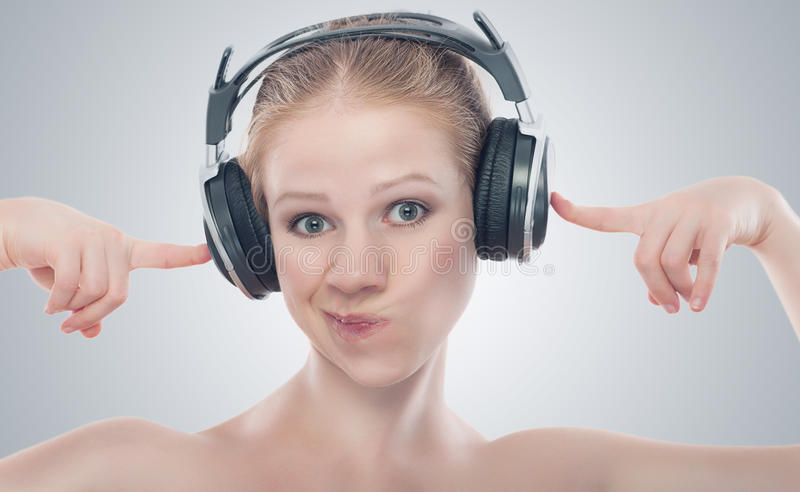 Funny Girl Listening To Music On Headphones Royalty Free Stock Photos