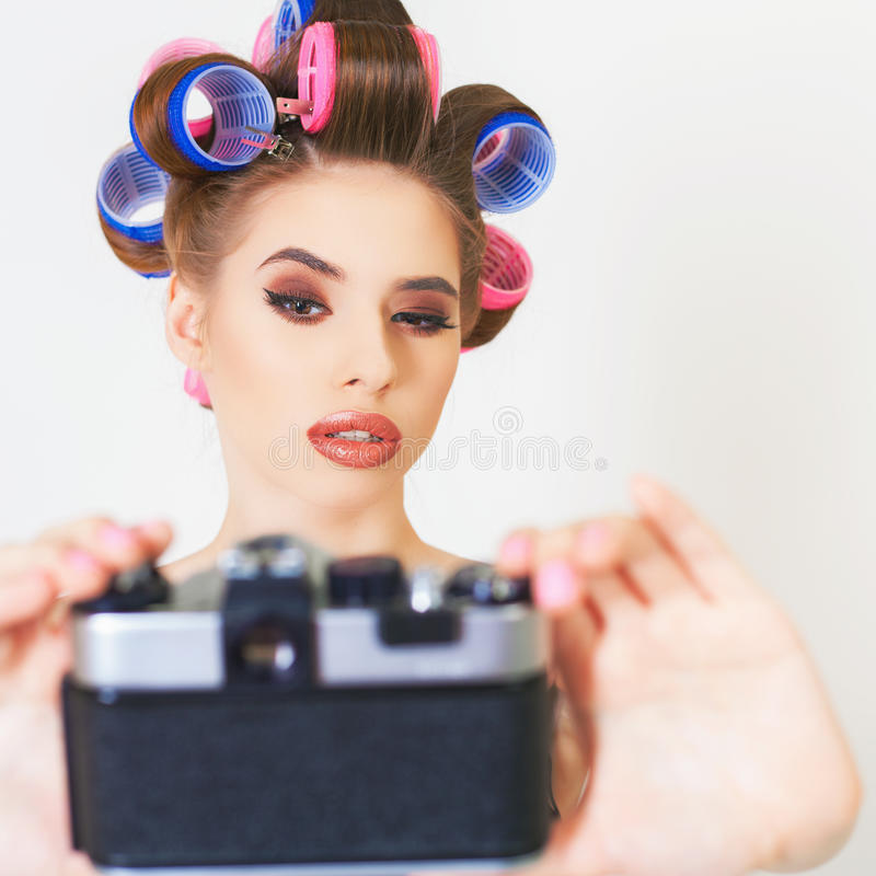 Funny girl make a foto selfie at vintage camera. Image of funny girl make a foto selfie at vintage camera. Take a photograph of himself. Fun, party. Beauty stock image